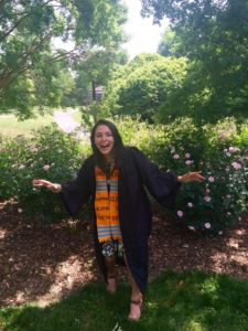 Kappa Alpha Theta Graduate wearing handwoven kente stole